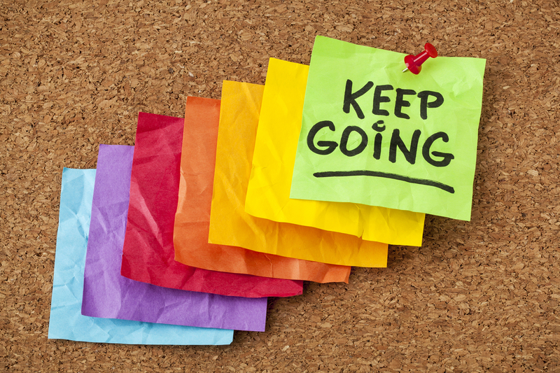 http://www.dreamstime.com/royalty-free-stock-photography-keep-going-motivation-concept-determination-handwriting-colorful-sticky-notes-image31396027