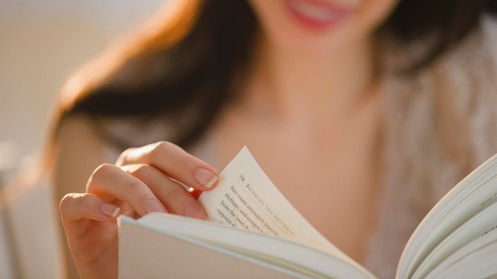GTY_woman_reading_book_jt_140112_16x9_992